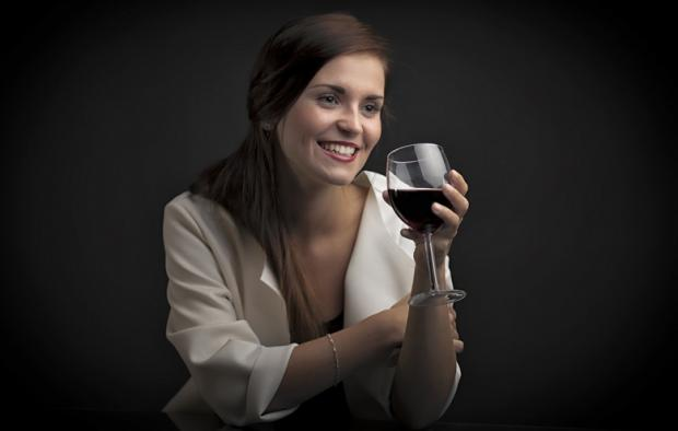 Glamour portrait of a woman with glass of red wine